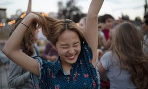 a girl dancing outdoors