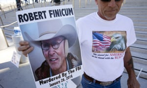 A supporter of Nevada rancher Cliven Bundy holds a sign of Arizona rancher LaVoy Finicum in front of the US courthouse in downtown Las Vegas.
