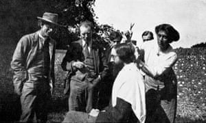Vanessa Bell cutting Lytton Strachey's hair while Roger Fry, Clive Bell, Duncan Grant and an unidentified guest look on, c1920.