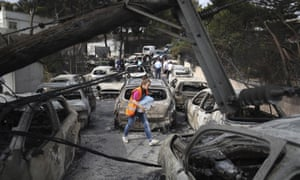 Burnt-out cars in Mati