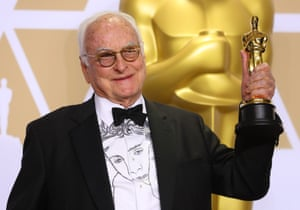James Ivory wears a shirt depicting actor Timothee Chalamet as he holds his Oscar for Best Adapted Screenplay for Call Me My Your Name