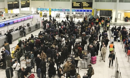 Passengers wait to check in at Gatwick in December as the airport tackles another drone crisis