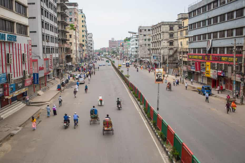 A nearly deserted thoroughfare cutting through the middle of Dhaka