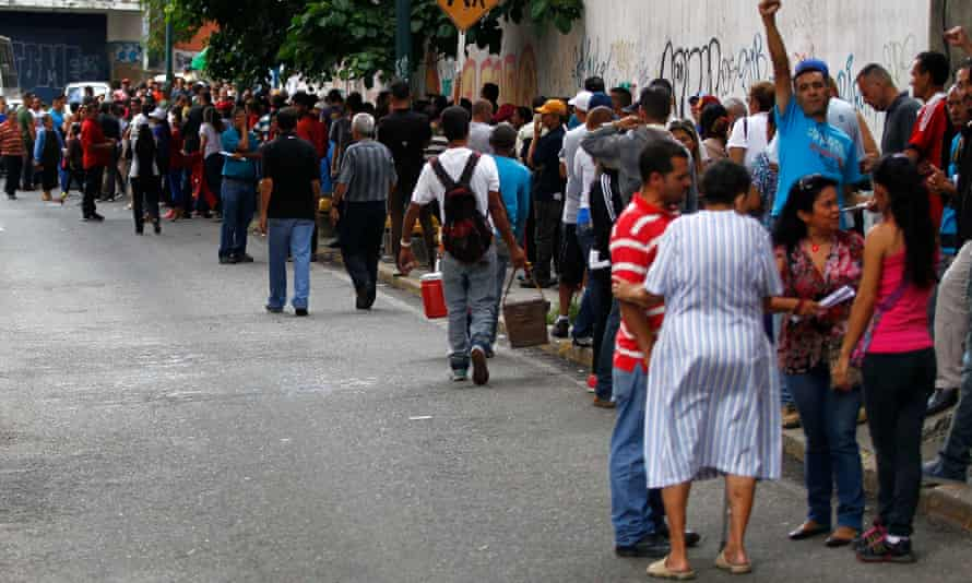 A queue outside a polling station in Caracas.