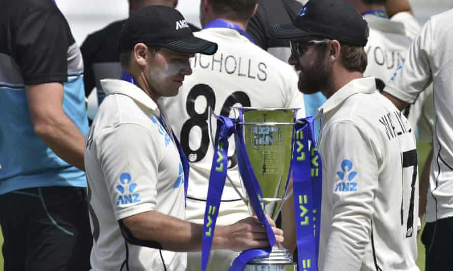 Tom Latham (left) holds the trophy won by New Zealand for their series victory against England.