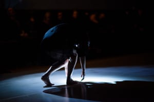 Dancer Wendy Morrow's final movements are performed by torchlight in Geologies