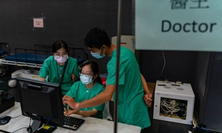 Medical workers at a makeshift coronavirus hospital in Hong Kong that can take up to 500 patients.
