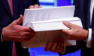 Hands hold the Brexit draft text