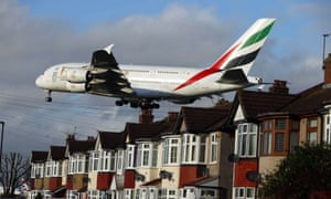 An Emirates Airbus A380 coming in to land over houses in Myrtle Avenue near Heathrow airport