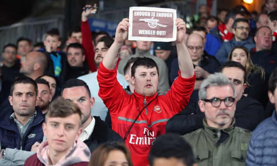 An Arsenal supporter makes clear his feelings at Selhurst Park on Monday night