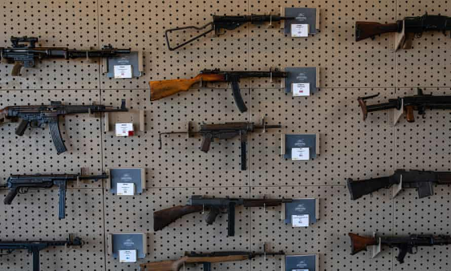 Historic firearms, which can be shot by visitors, are displayed on a wall at the living military museum at the Ox Ranch.