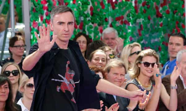 Raf Simons appears at the end of his show.