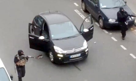 A frame grab taken from footage made available and posted by Jordi Mir shows hooded gunmen aiming Kalashnikov rifles towards a police officer, before shooting him dead.