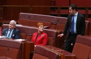 Labor's senator Sam Dastyari talks to One Nation senators Pauline Hanson and Brian Burston as the Senate continues debating the changes to the marriage act in Parliament House