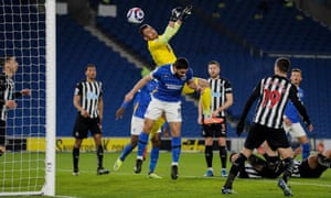 Martin Dubravka goalkeeper of Newcastle United above Neal Maupay of Brighton & Hove Albion/