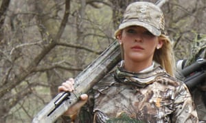 Theresa Vail walks with a hunting party in Chase County, Kansas. Vail, a former beauty queen, is among the members of Donald Trump Jr's 'second amendment coalition'.