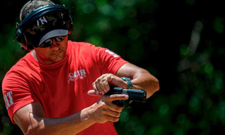 An instructor prepares a gun at a shooting club in Belém, Pará state, Brazil, on 25 July.