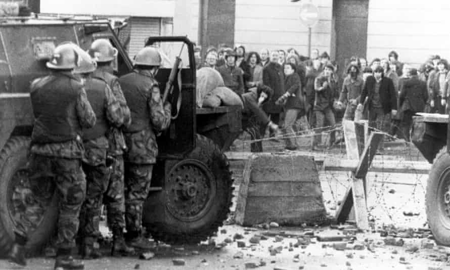 Catholic demonstrators and British troops face one another in Derry, Northern Ireland.