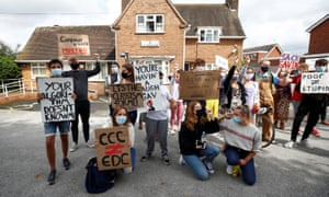 A-level students hold placards as they protest about their exam results at the constituency offices of Education Secretary Gavin Williamson, in South Staffordshire today.