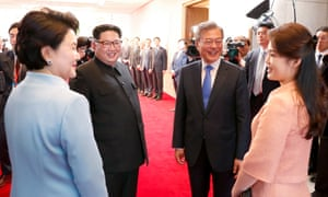 The South Korean first lady, Kim Jung-sook, and the North Korean first lady, Ri Sol-ju, arrive at the Peace House