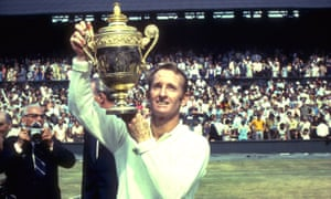 Rod Laver lifts the men's singles trophy at Wimbledon in 1969