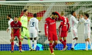 Players from both sides, including Liverpool's Mohamed Salah, react at full time.