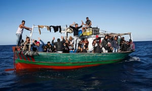 A boatload of migrants making the crossing from Tunisia to Sicily