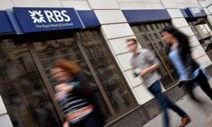People walk past an RBS branch in London