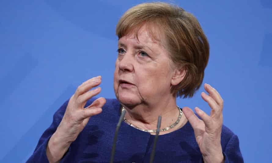Angela Merkel gesturing with both hands.