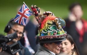 A man with a colourful hat as crowds gather outside Windsor Castle