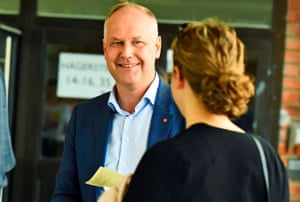 Jonas Sjoestedt, leader of the Swedish left wing party Vaensterpartiet, speaks with a voter outside of a polling station at the Midsommarkransen high school in Stockholm