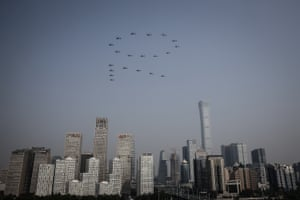 Planes from the Chinese People's Liberation Army (PLA) air force fly in formation during a massive parade to celebrate the 70th anniversary of the founding of the People's Republic of China
