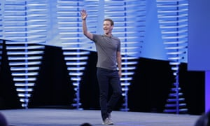 Mark Zuckerberg waves while walking on stage to deliver the keynote address at Facebook's F8 conference.