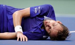 Daniil Medvedev lies on the court in disbelief after beating world No 1 Novak Djokovic at Arthur Ashe Stadium.