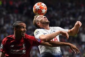 Liverpool's defender Joel Matip (left) and Tottenham Hotspur's Harry Kane jump for the ball
