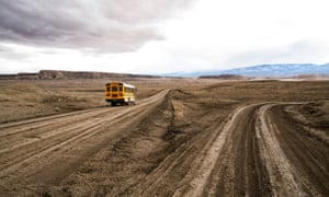 A school bus on the unpaved Indian service route 5010 near Sanostee. The seven-mile corridor connects as many as 2,500 residents to the outside world – or denies them access altogether.