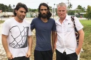 Farhad Bandesh with his fellow Manus detainee Behrouz Boochani and Not Drowning, Waving singer David Bridie