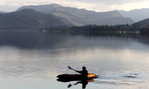 A canoeist glides across Ullswater, the second biggest lake in the region.