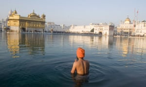 A Sikh man in the sacred pond of the Golden Temple, Amritsar