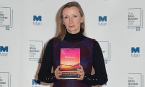 Anna Burns with a copy of her novel Milkman