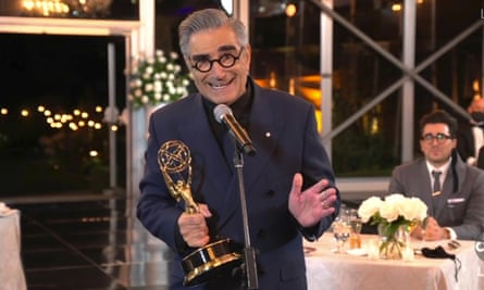 Eugene Levy accepts the Emmy for best actor in a comedy series at a remote location with his cast mates from Schitt's Creek, which swept the comedy awards with seven wins.
