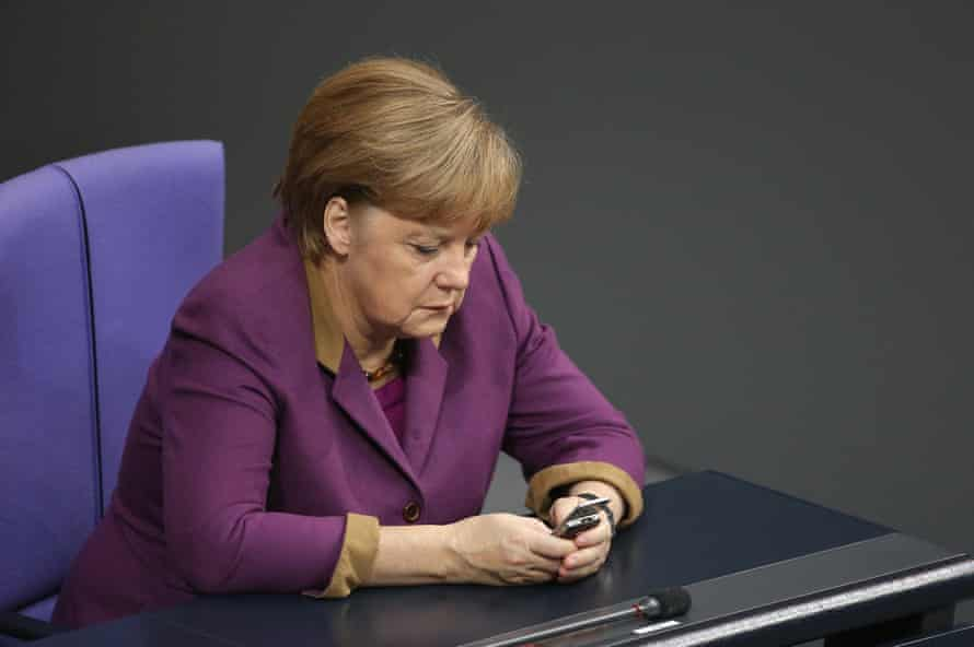 Merkel checks her phone during a session of the Bundestag in November 2012
