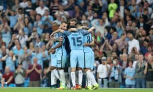 Aguero and his team-mates celebrate.