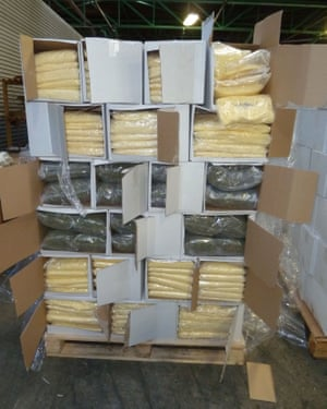 Boxes of cannabis and pizza cheese stacked