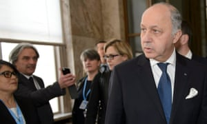 French Foreign Minister Laurent Fabius arrives for the first round of the UN climate talks, in Geneva, Switzerland.