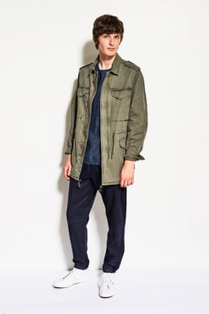Model wears an army jacket and jogging pants