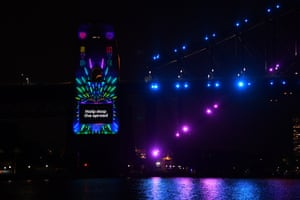The Sydney Harbour Bridge pylon is lit with a Covid-19 safety message ahead of the midnight fireworks