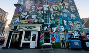 Exterior of the Prince Albert pub in Brighton, showing its colourful mural of artists, musicians and celebrities.