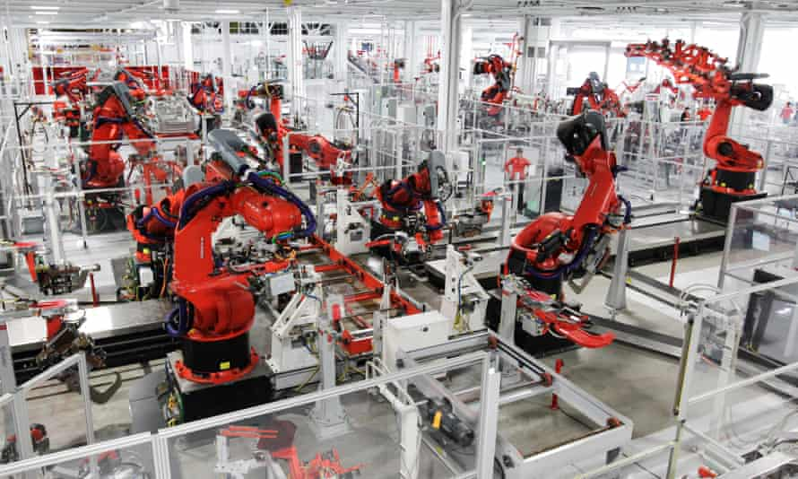 Robots assembly a Tesla Model S at the firm's factory in Fremont, California