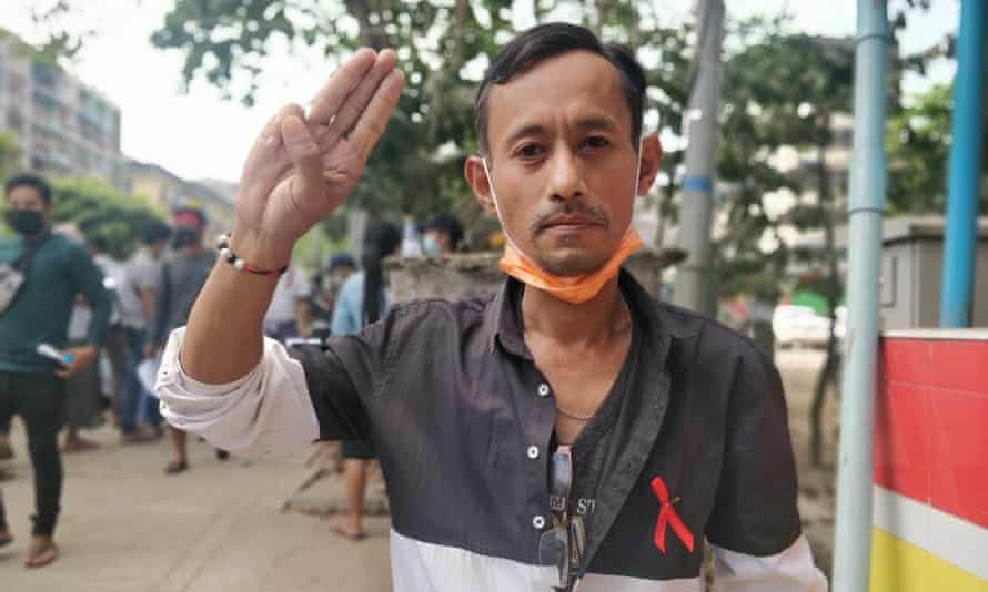 Zaw, 40, gives the three-finger salute in Yangon on Monday.